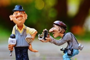character figures illustrating news reporter and photographer