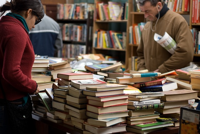 tables of books, people looking at books