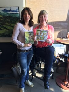 Kathleen Gauer & Veronica Kitchen, authors of illustrated children's books, holding their books at meeting to collaborate