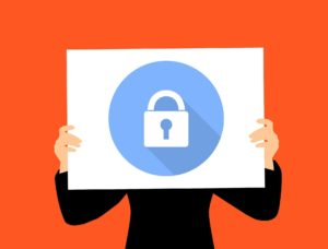 illustration of person holding up sign with picture of a lock