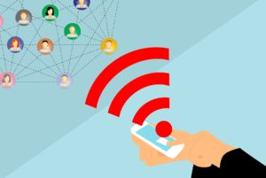 drawn image of hand holding phone with sound icon going out to network of heads representing people